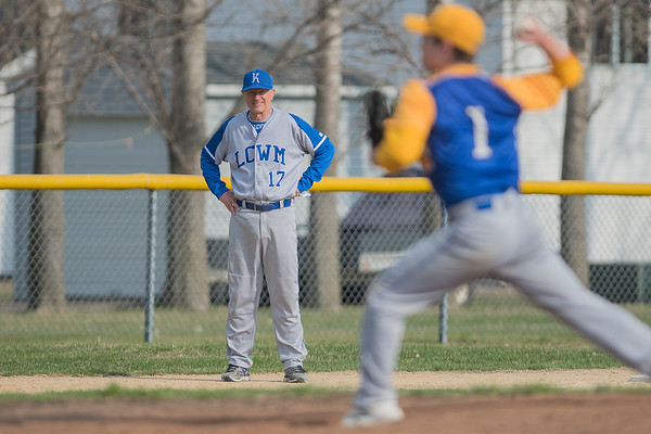 John Madsen, head coach of the Lake Crystal Wellcome Memorial baseball team, watches an opposing pitcher throw as he manned third base coaching duties. Photo by Jackson Forderer
