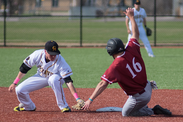 Gustavus' shortstop Cole Pengilly loses the ball from his glove while attempting to tag out Hamline's Jeremy Szura (16) as Szura attempted to steal second base. The Gusties swept Hamline in a doubleheader on Wednesday, winning 3-0 and 4-3. Photo by Jackson Forderer