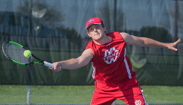 Ford Johnson of Mankato West stretches out for a forehand in the first doubles match against Prior Lake on Friday. West lost to Prior Lake 4-3. Photo by Jackson Forderer