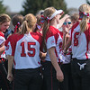 The Mankato West softball team breaks their huddle in celebration after defeating Edina 7-2 in a round robin tournament on Saturday at Caswell Park. The Scarlets finished the tournament with a record of 2-1. Photo by Jackson Forderer