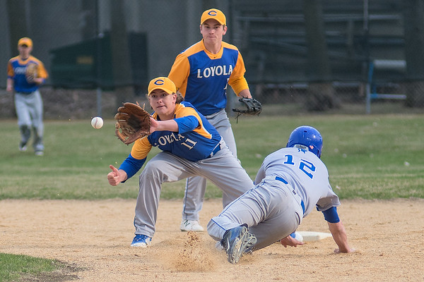 Mankato Loyola's Sam Sernett gets a throw from the catcher and would tag out Lake Crystal Wellcome Memorial's Garret Wiens at second base. The Crusaders swept the Knights in a doubleheader on Tuesday, 11-0 and 4-0. Photo by Jackson Forderer