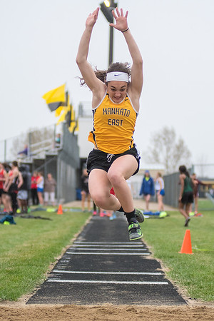 Mankato East's Jenny Vetter competes in the triple jump field event at the Cougar Relays held on Thursday. Vetter and her teammates took first place in the event. Photo by Jackson Forderer