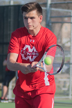Devan Schaefer of Mankato West hits a backhand volley in the second doubles match against Prior Lake on Friday. Photo by Jackson Forderer