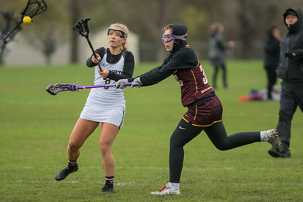 Mankato's Alexis Peterson takes a shot on goal while Northfield's Laura Gates tries to block the shot during Tuesday's game. Photo by Jackson Forderer