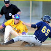 Minnesota State's Pat Dockendorf tags out Regis baserunner Steven Brault as he tries to steal third during the second inning of their NCAA Division II Central Region baseball game Thursday at Franklin Rogers Park.