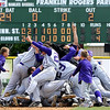 Minnesota State baseball players celebrate after beating St. Cloud State 5-4 in the NCAA Division II Central Region championship game Sunday at Franklin Rogers Park.