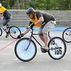 Zach Brooks is shadowed by Andy Dowd (left) and Sophie Kaeter as he brings the ball up the rink during a bike polo match Thursday at the Stoltzman Road rink.