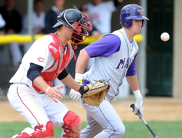 Minnesota State's Matt Odegaard watches as his bunt attempt pops in front of him and St. Cloud State catcher Michael Jurgella during their NCAA Division II Central Region baseball championship game Sunday at Franklin Rogers Park.