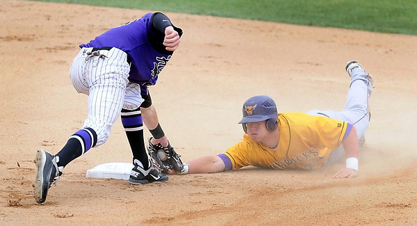 Minnesota State's Matt Odegaard barely clings to second base as New Mexico Highlands second baseman Thomas King applies the tag during the first inning of their game Saturday in the NCAA Division II Central Region tournament.