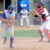 Minnesota State's Matt Kuchenbecker celebrates after sliding under the tag of St. Cloud State catcher Michael Jurgella to score the go ahead run in the top of the ninth inning during their NCAA Division II Central Region championship game Sunday at Franklin Rogers Park.