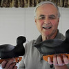 John Cross<br /> Mankato carver Dave Jackson displays a pair of coot confidence decoys that garnered a first place and second place in recent world decoy carving competition in Maryland.