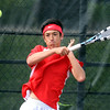 Mankato West's Bill Leitch returns a serve during his singles match against Hutchinson Thursday at the West courts.
