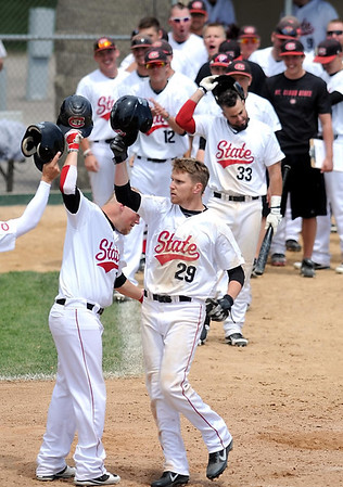 St. Cloud State's Garrett Fischer (29), a New Ulm native, is congratulated by teammates after hitting a grand slam home run against Minnesota State during their first game in the NSIC championship Saturday at Franklin Rogers Park.