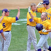 Minnesota State's Matt Kuchenbecker is congratulated by teammates after a first inning solo home run during their game against New Mexico Highlands Saturday in the NCAA Division II Central Region tournament.