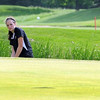 Mankato East's Caitlin Clause chips onto the 17th green during their meet against New Ulm Saturday at North Links Golf Course.