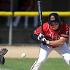Mankato West's Isaac Weber takes a pitch during the first game of a doubleheader Tuesday.