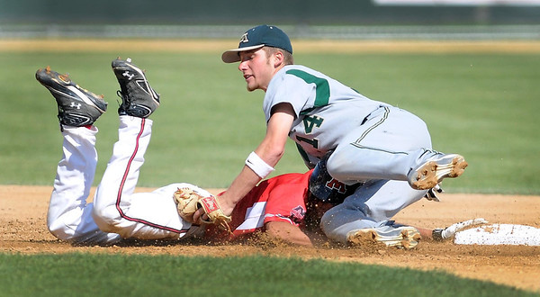Mankato West's Tyler Stoffel slips back into second base ahead of the tag by Rochester Mayo's Kyle Van Wettering during the first game of a doubleheader Tuesday at Franklin Rogers Park.