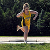 Mankato East's Morgan Urbatch winds up during the girls shot put Wednesday at the East track.