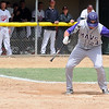 Minnesota State's Matt Odegaard can't avoid getting hit by a pitch during the ninth inning of their NCAA Divison II Central Region championship game against St. Cloud State Sunday.