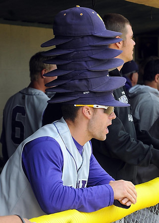 Minnesota State's Parker Sullivan dons all of the rally caps during the eighth inning of their NCAA Division II Central Region championship baseball game Sunday at Franklin Rogers Park.