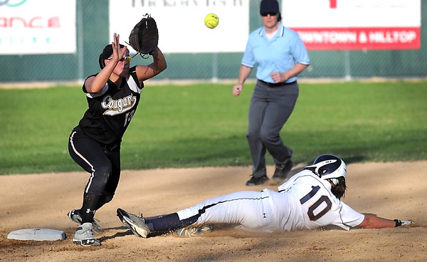 Pat Christman<br /> Prior Lake's Shannon Borchardt steals second as Mankato East's Savannah Quandt fields the throw during the fourth inning Tuesday at Thomas Park.