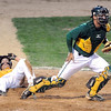 Pat Christman<br /> Minnesota State's Parker Sullivan lies on the ground after being tagged out at the plate by Missouri Southern State's Sam Ryan during their NCAA Division II Central Region baseball tournament game Thursday at Franklin Rogers Park.
