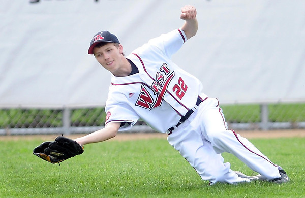 Pat Christman<br /> Mankato West's Sam Olson pulls in a fly ball during Thursday's game against Mankato East at Wolverton Field.