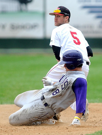 Pat Christman<br /> Minnesota State's Connor McCallum is out as he slides into second base as St. Cloud State's Travis Carriveau looks to throw to third during their NCAA Division II Central Region championship game Sunday at Franklin Rogers Park.