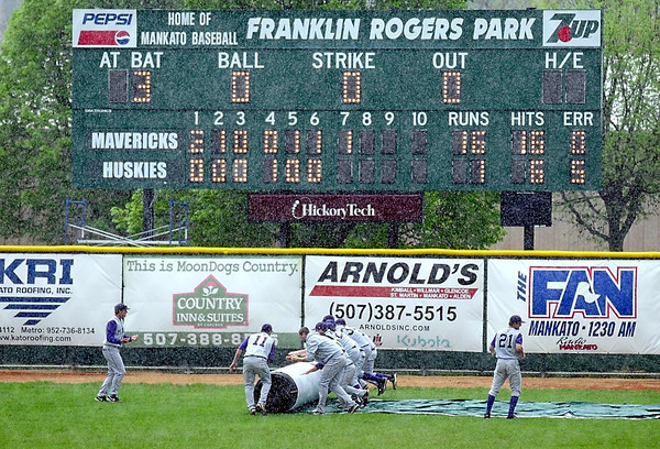 Pat Christman<br /> Minnesota State baseball players help roll out infield cover during a rain delay in the middle of the seventh inning of their NCAA Division II Central Region championship game against St. Cloud State Sunday at Franklin Rogers Park.
