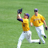 Pat Christman<br /> Minnesota State right fielder Scott Lindner (8) is watched by center fielder Parker Sullivan as he tracks down a fly ball during Saturday's NCAA Division II Central Region semifinal game against St. Cloud State.