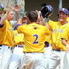 Pat Christman<br /> Minnesota State's Taylor Brnastad is congratulated by teammates after scoring on a balk by St. Cloud State pitcher Chris Kubitz in the fifth inning of their NCAA Division II Central Region semifinal game Saturday at Franklin Rogers Park.