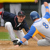 Loyola's Shane Sellner is tagged out by United South Central pitcher Trevor Stencel while attempting to steal home on a past ball during fourth inning action at Franklin Rogers Park on Monday. Photo by John Cross