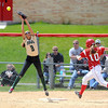 The ball sails over the glove or Rochester Mayo's Nikki Ketzeback as Mankato West's Hannah Hastings makes it safely to first base during the first game of a doubleheader Saturday at the West field. Photo by Pat Christman