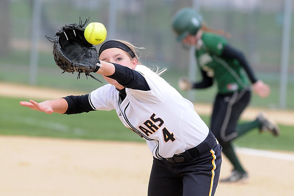 Mankato East pitcher Morgan Keim-Wolfe reaches out to catch a line drive during the second inning against Faribault Thursday at Thomas Park. Photo by Pat Christman