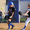 Mankato Loyola's Megan Schroeder scores ahead of the throw to Janesville-Waldorf-Pemberton pitcher Emma Eustice after a wild pitch in the third inning Tuesday at the Loyola field. Photo by Pat Christman