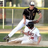 Mankato West's Steven Nessler slides into third base as Mankato East's Luke Makovsky tries to apply the tag during a game Saturday at Franklin Rogers Park. Photo by Pat Christman