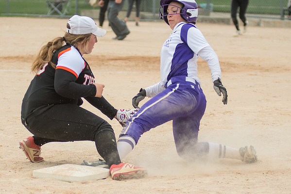 New Ulm's Carli Botten slides safely back to third base with a tag being applied by Farmington's Emma Frost during a run down. New Ulm took second place in the Mankato East Invitational Tournament. Photo by Jackson Forderer