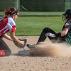 Faribault's Ellie Knutson (right) slides safely into second base ahead of a tag attempt by Mankato West's Jalissa Stoltzman. Faribault won the game 2-0 to claim the Big 9 conference title. Photo by Jackson Forderer