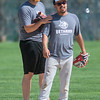 Alex Babcock (left), pitcher with Bethany Lutheran, jokes around with Diego Martiarena at practice on Tuesday as teammates took batting practice. Photo by Jackson Forderer