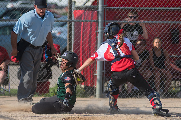 Mankato West catcher Bri Stoltzman tags out Faribault's Bre Bresnahan at home plate during Thursday's Big 9 conference game. Faribault shutout the Scarlets 2-0 and won the Big 9 conference title. Photo by Jackson Forderer