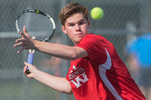 Mankato West's Brandon Swenson prepares to hit a forehand against his opponent from Hutchinson in the fourth singles match played on Thursday. The Scarlets won the match to advance in the Section 2AA tournament. Photo by Jackson Forderer