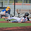 Mankato Loyola's Matthew Kujawa tries to apply a tag to Cleveland's Karson Lindsay at third base but loses control of the ball during Saturday's game played at Franklin Rogers Park. Loyola won a back-and-forth battle 7-6. Photo by Jackson Forderer