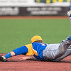 Mankato Loyola's Sam Sernett makes a diving stop on a ground ball during Saturday's game against Cleveland at Franklin Rogers Park. Photo by Jackson Forderer