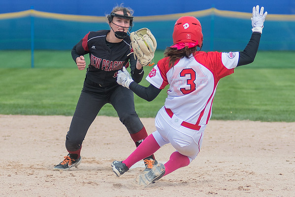Mankato West's Jalissa Stoltzman is tagged out at second base by New Prague's Kennedy Buckman on a stealing attempt by Stoltzman. Photo by Jackson Forderer