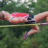 Erica Benson of Mankato West clears the bar in the high jump at Tuesday's track meet. Benson also competes in the 100, 200 and 400 meter dashes. Photo by Jackson Forderer