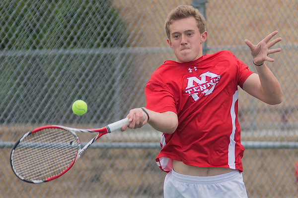 Mankato West's Ford Johnson hits a forehand during his match against a Hutchinson opponent on Thursday. Johnson played in the number two singles match for the Scarlets. Photo by Jackson Forderer