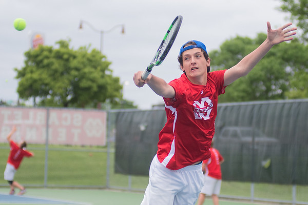 Will Mueller of Mankato West's number one doubles team hits a backhand volley back to his Hutchinson opponents. Photo by Jackson Forderer