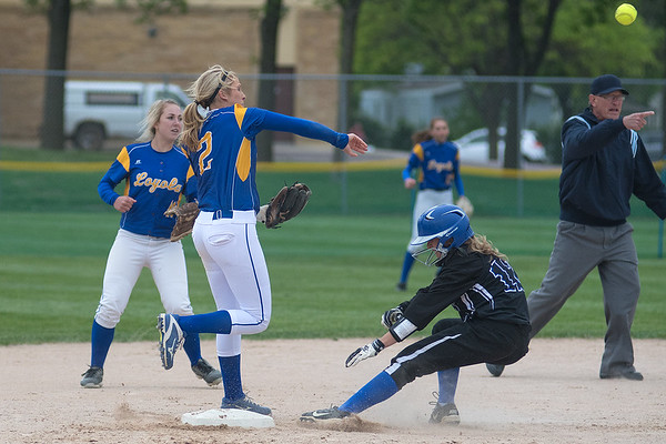 Mankato Loyola's Rae Dose (2) makes the force at second base on Martin County West's Alyssa Williamson and completes the double play with a throw to first in the Valley Showcase championship game. Loyola came back to win the game 9-8. Photo by Jackson Forderer