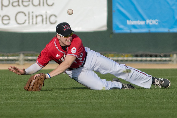 A fly ball gets past Mankato West's Wesley Henderson after he attempted to make a diving catch in the Scarlets' conference game played against Rochester Mayo on Friday. West lost the game 7-6. Photo by Jackson Forderer