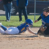 Mankato Loyola's Rae Dose (2) slides safely back to third base ahead of a tag from Lake Crystal-Wellcome-Memorial's McKenzie Glaubitz during Tuesday's conference game played at Loyola. Photo by Jackson Forderer